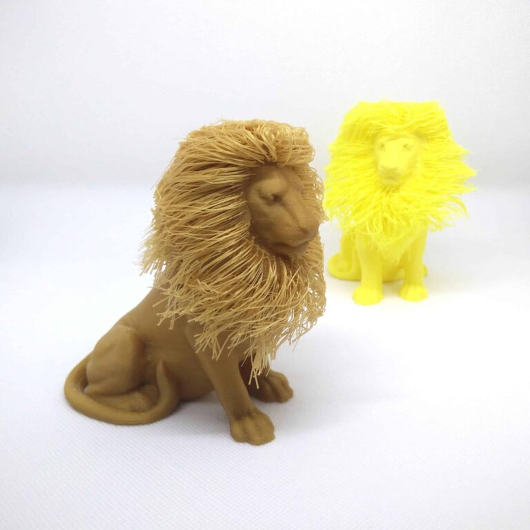 A gold and a yellow 3D printed hairy lion