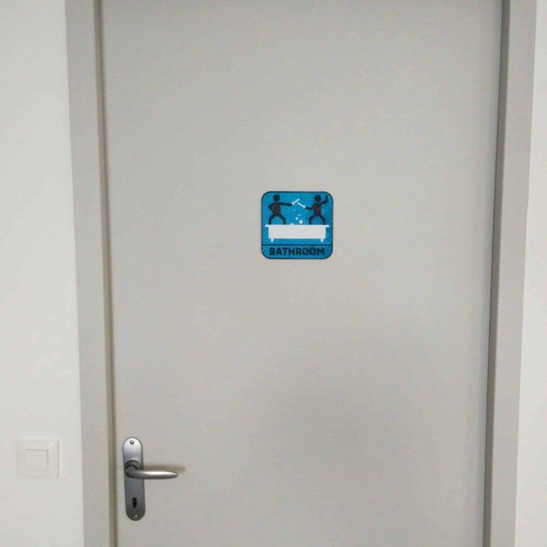 Original bathroom door sign